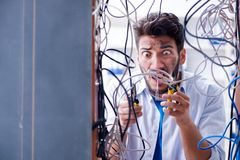 The computer repairman working on repairing network in it workshop Stock Photography