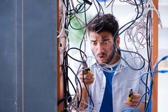 The computer repairman working on repairing network in it workshop. Computer repairman working on repairing network in IT workshop Stock Images