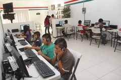 Computer room donated by Rotary International. Children and adolescents in a marginalized area of Aguascalientes, Mexico used a computer room, community hall Royalty Free Stock Image