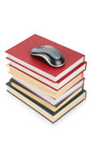 Computer`s mouse on pile of books Stock Photography