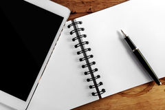 Computer screen,book and pen Stock Photos