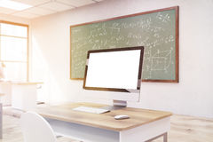 Computer screen in classroom. Stock Photos