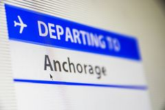 Computer screen close-up of flight to Anchorage. Computer screen close-up of status of flight departing to Anchorage, Alaska, USA Stock Image