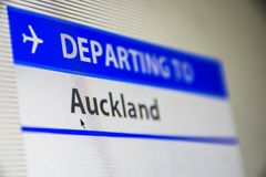 Computer screen close-up of flight to Auckland, New Zealand. Computer screen close-up of status of flight departing to Auckland, New Zealand Royalty Free Stock Image