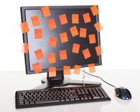 Computer screen covered in sticky notes Stock Photos