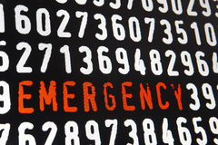 Computer screen with emergency text on black background Royalty Free Stock Photography