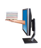 Computer screen and hand with books. Royalty Free Stock Images