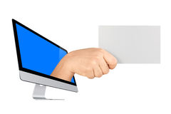 Computer Screen Hand Holding Blank Card Isolated. Big female hand coming out from computer screen showing large blank card isolated white background Royalty Free Stock Images