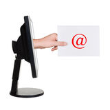 Computer screen and hand with letter Stock Photos