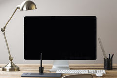 Computer screen. Image of a computer screen with a lamp and drawing tablet royalty free stock images