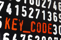 Computer screen with key code text on black background Royalty Free Stock Images