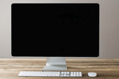 Computer screen and keyboard and mouse on a wood table with whit Stock Photos