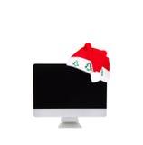 Computer screen in santa hat Royalty Free Stock Image