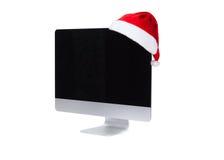 Computer screen in santa hat Royalty Free Stock Photo