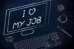 Computer screen saying I love my job among other objects on the Stock Photo