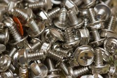 Computer screws. Macro of shiny computer screws Royalty Free Stock Photo