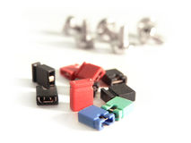 Computer screws and jupper switches. A lot of computer screws and jupper switches Stock Photography