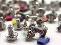 Computer screws and jupper switches. A lot of computer screws and jupper switches Royalty Free Stock Images