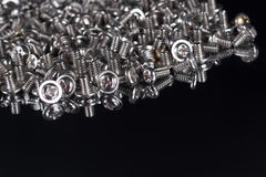 Computer screws in a mirror Royalty Free Stock Image