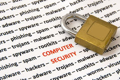 Computer security. A lot of topics about computer security  (words in red) and a lock - concept background Stock Photography