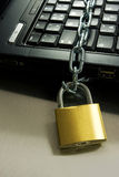 Computer security. Strong Security Lock & Chain on PC keyboard Stock Photos
