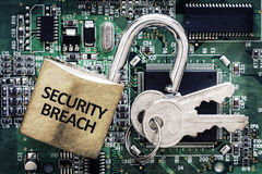 Computer security breach. Internet computer security and network protection concept, padlock and key on circuit board Royalty Free Stock Photos