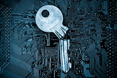 Computer security. A broken key on computer circuitboard background / computer security breach concept stock images