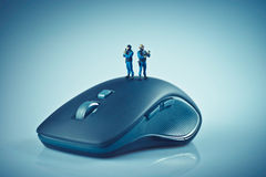 Computer security concept. Miniature SWAT team on top of computer mouse. Computer security concept. Macro photo Royalty Free Stock Image