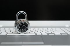 Computer security concept, padlock on laptop keyboard. royalty free stock image