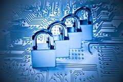Computer security. Four metal locks on computer circuit board - computer security stock photos