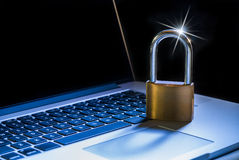 Computer security. Laptop computer and padlock as a metaphor for information security Royalty Free Stock Images