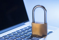 Computer security. Laptop computer and padlock as a metaphor for information security Royalty Free Stock Photos