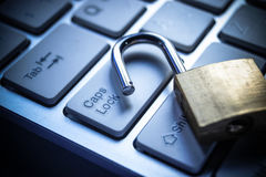Computer security. Open security lock on computer keyboard - computer security breach concept Royalty Free Stock Photo