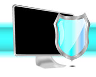 Computer with shield for protection Royalty Free Stock Photography