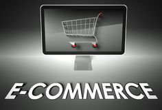 Computer and shopping cart with E-commerce, Business Stock Photos