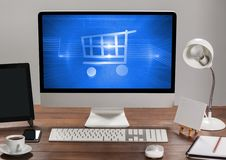 Computer with Shopping trolley icon Royalty Free Stock Photography