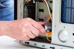 Computer specialist. Men fixing a hardware with screwdriver Royalty Free Stock Photos
