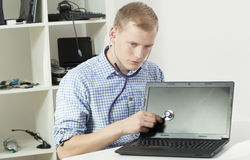 Computer specialist with stethoscope Stock Photos