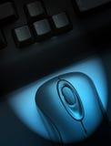 Computer in the spotlight Stock Photos