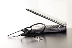 Computer and stethoscope on the table. Stock Images