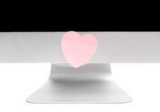 Computer with a sticky note in the shape of a heart Royalty Free Stock Photos