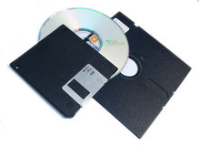 Computer storage media. Various computer storage media: 3 1/2' floppy, 5 1/4' floppy, cd Isolated on white Royalty Free Stock Photo