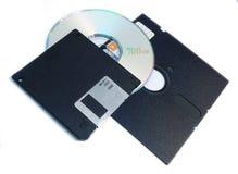 Computer storage media. Various computer storage media: 3 1/2' floppy, 5 1/4' floppy, cd Isolated on white royalty free stock photo