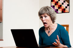 Computer stress. This computer user shows huge amounts of stress and anger at this program / crash / loss of data. Powerful frustration image Stock Photos