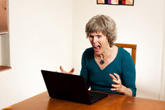 Computer stress. This computer user shows huge amounts of stress and anger at this program / crash / loss of data. Powerful frustration image royalty free stock images