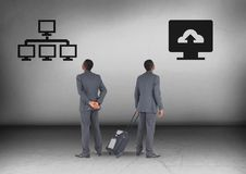 Computer system or computer cloud storage upload with Businessman looking in opposite directions. Digital composite of Computer system or computer cloud storage Stock Photos