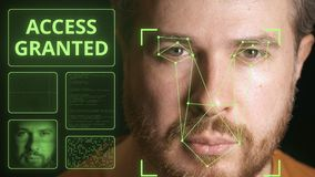 Computer system scans man`s face and identifies person. Access granted. Computer system scans face and identifies person stock video footage