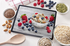Computer Tablet Cereal Berries Nuts Grains Breakfast stock images