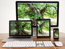 Computer and tablet. IMac, iPad, iPhone, Macbook Pro on table Royalty Free Stock Photo