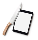 Computer tablet and knife Royalty Free Stock Photography